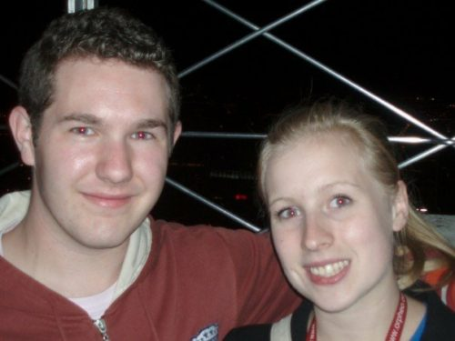 Rosie and Karl smile at the top of the Emire \State Building.