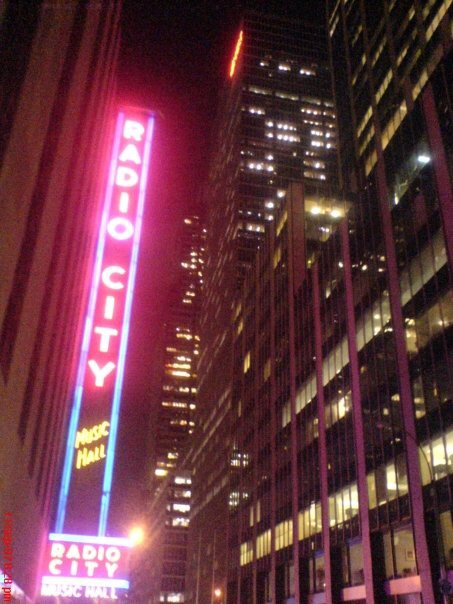 A bright pink Radio City Music Hall sigh glows in the dark