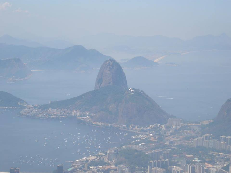 A hazy photo of Sugar Loaf Mountain from Cristo Redentor, Rio de Janeiro