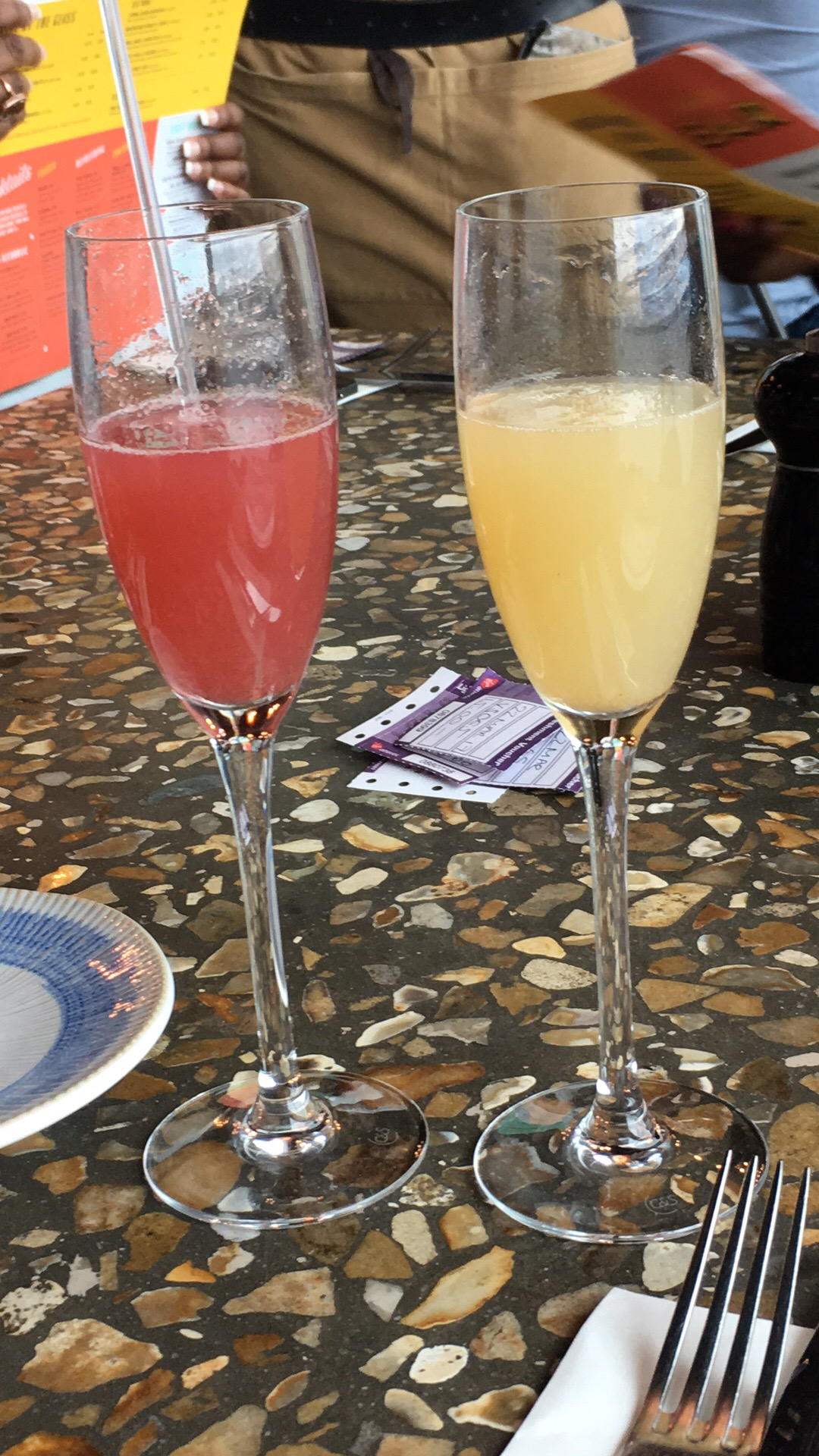 Two cocktails, both prosecco based. One pink and one yellow.