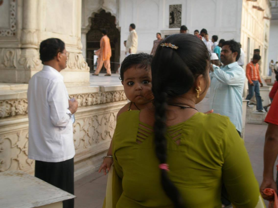 Indian baby stares at us.